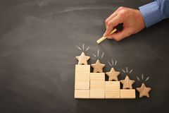 Concept image of setting a five star goal. increase rating or ranking, evaluation and classification idea. Top view. Flat lay. Concept image of setting a five royalty free stock image