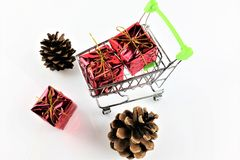 An concept Image of a Shopping cart with a gift - christmas Royalty Free Stock Photos