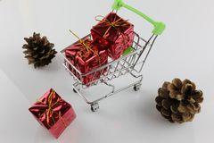 An concept Image of a Shopping cart with a gift - christmas Royalty Free Stock Photography