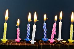 An concept Image of some candles at a children birthday party. Abstract royalty free stock images