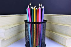 An concept Image of some colorful pencils with some books royalty free stock images