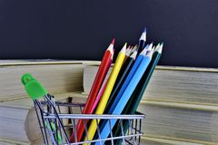 An concept Image of some colorful pencils with some books and copy space. Abstract Royalty Free Stock Image