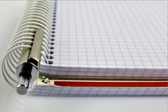 An concept Image of a spiral Notebook with a pen and copy space. Abstract Stock Photography