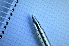 An concept Image of a spiral Notebook with a pen and copy space. Abstract Royalty Free Stock Images