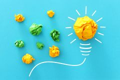Concept image of successful idea, crumpled paper and light bulb sketch, brainstorming and creative thinking.  stock photos