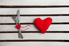 Concept image for Valentine dining, fork, spoon and red heart Stock Photos