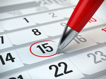 Concept of important day, reminder, organizing time and schedule. Red pen marking day of the month on a calendar Stock Photography