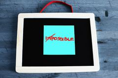 Concept of impossible that becomes possible written on the black royalty free stock photos