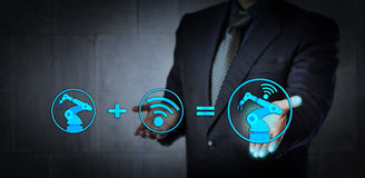 Concept For Industry 4.0, Smart Factory and IoT. Blue chip consultant offering technology solution. A six axis industrial robot icon plus a wireless data royalty free stock photography