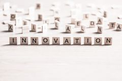 Innovation scrabble word. Concept of innovation made of wooden elements with the letters royalty free stock image