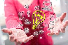Concept of innovative idea. Innovative idea concept above the hands of a woman in background stock photos