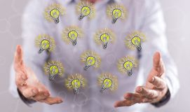Concept of innovative ideas. Innovative ideas concept above the hands of a man in background stock photo