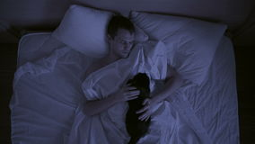 Concept of insomnia, the couple tosses in his sleep, a top view. Restless sleep stock video footage
