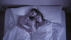 Concept of insomnia, the couple tosses in his sleep, a top view. Restless sleep stock video