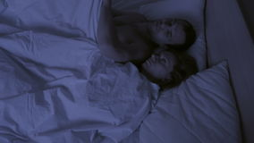 Concept of insomnia, the couple tosses in his sleep, a top view. Restless sleep stock footage