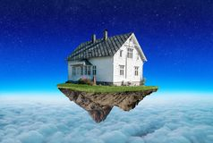 Concept insurance, the house on the island levitates Royalty Free Stock Image