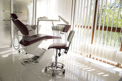Concept - interior of new modern dental clinic office with chair.. Concept of dental. stomatology concept - interior of new modern dental clinic office with Royalty Free Stock Photos