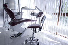 Concept - interior of new modern dental clinic office with chair.. Concept of dental. stomatology concept - interior of new modern dental clinic office with Royalty Free Stock Photography