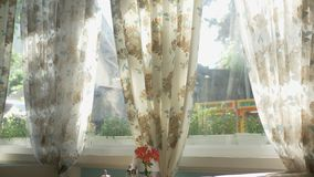 Concept of interior windows. large windows full-length decorated with floral print curtains stock illustration