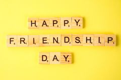 The concept for the international friendship day. Text on a yellow pastel background. The concept for the international friendship day. Text on a yellow pastel royalty free stock image
