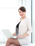 Concept of the Internet:a beautiful woman administrator with lap Stock Image