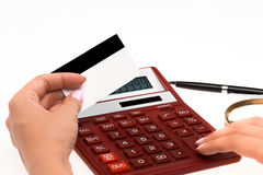 Concept for Internet shopping: hands with calculator and credit card Stock Photo