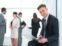 Concept of the Internet: a successful student with laptop deals Stock Image