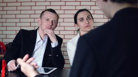 The concept of interview with candidate and two of the interviewer. The concept of interview with candidate and two interviewer stock video footage