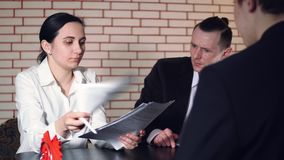 The concept of interview with candidate and two of the interviewer. The concept of interview with candidate and two interviewer stock video