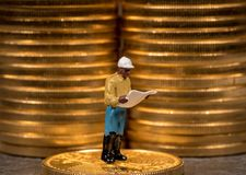 Concept of investment in gold with US Treasury Gold Eagle coins. Concept illustration of miners looking for new gold eagle US Treasury golden coins royalty free stock images