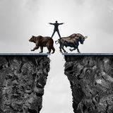 Concept Of Investment Risk. As a businessman balancing on top of a bear and bull as a financial metaphor for the danger of managing stock market forces of Stock Images