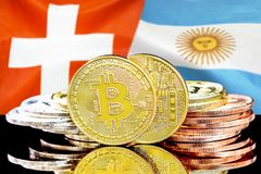 Bitcoins on Switzerland and Argentina flag background. Concept for investors in cryptocurrency and Blockchain technology in the Switzerland and Argentina stock images