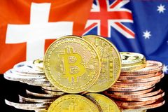 Bitcoins on Switzerland and Australia flag background. Concept for investors in cryptocurrency and Blockchain technology in the Switzerland and Australia royalty free stock image