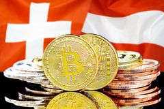 Bitcoins on Switzerland and Austria flag background. Concept for investors in cryptocurrency and Blockchain technology in the Switzerland and Austria. Bitcoins royalty free stock photos