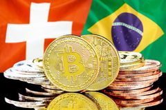 Bitcoins on Switzerland and Brazil flag background. Concept for investors in cryptocurrency and Blockchain technology in the Switzerland and Brazil. Bitcoins on stock photos
