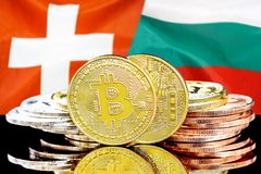 Bitcoins on Switzerland and Bulgaria flag background. Concept for investors in cryptocurrency and Blockchain technology in the Switzerland and Bulgaria. Bitcoins royalty free stock photography