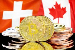 Bitcoins on Switzerland and Canada flag background. Concept for investors in cryptocurrency and Blockchain technology in the Switzerland and Canada. Bitcoins on royalty free stock image