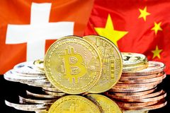 Bitcoins on Switzerland and China flag background. Concept for investors in cryptocurrency and Blockchain technology in the Switzerland and China. Bitcoins on stock photos