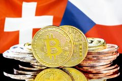 Bitcoins on Switzerland and Czech Republic flag background. Concept for investors in cryptocurrency and Blockchain technology in the Switzerland and Czech royalty free stock photo