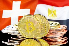 Bitcoins on Switzerland and Egypt flag background. Concept for investors in cryptocurrency and Blockchain technology in the Switzerland and Egypt. Bitcoins on royalty free stock image