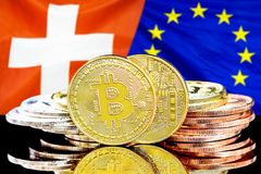 Bitcoins on Switzerland and European Union flag background. Concept for investors in cryptocurrency and Blockchain technology in the Switzerland and European stock images