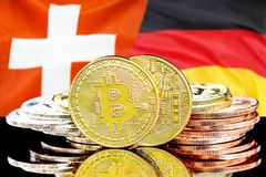 Bitcoins on Switzerland and Germany flag background. Concept for investors in cryptocurrency and Blockchain technology in the Switzerland and Germany. Bitcoins royalty free stock photo
