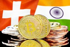 Bitcoins on Switzerland and India flag background. Concept for investors in cryptocurrency and Blockchain technology in the Switzerland and India. Bitcoins on royalty free stock photo