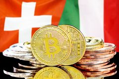 Bitcoins on Switzerland and Italy flag background. Concept for investors in cryptocurrency and Blockchain technology in the Switzerland and Italy. Bitcoins on stock photo