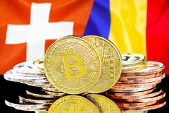 Bitcoins on Switzerland and Moldova flag background. Concept for investors in cryptocurrency and Blockchain technology in the Switzerland and Moldova. Bitcoins stock photo