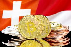 Bitcoins on Switzerland and Monaco flag background. Concept for investors in cryptocurrency and Blockchain technology in the Switzerland and Monaco. Bitcoins on stock images