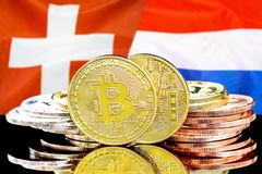 Bitcoins on Switzerland and Netherlands flag background. Concept for investors in cryptocurrency and Blockchain technology in the Switzerland and Netherlands royalty free stock photo