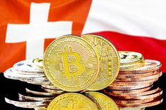 Bitcoins on Switzerland and Poland flag background. Concept for investors in cryptocurrency and Blockchain technology in the Switzerland and Poland. Bitcoins on stock image