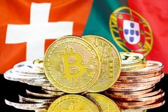 Bitcoins on Switzerland and Portugal flag background. Concept for investors in cryptocurrency and Blockchain technology in the Switzerland and Portugal. Bitcoins stock images