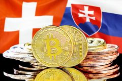Bitcoins on Switzerland and Slovakia flag background. Concept for investors in cryptocurrency and Blockchain technology in the Switzerland and Slovakia. Bitcoins stock photo